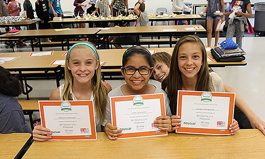 group of young girls with STEM certificates and happy smiles photo