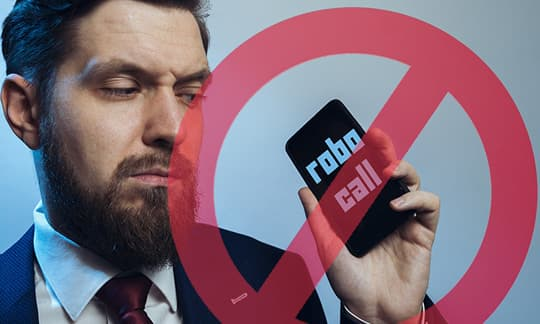 photo of business man holding phone